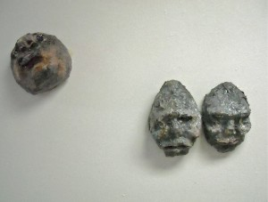 Gray Heads, acrylic, modeling paste, and mixed media
