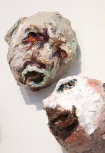Two Heads, acrylic, modeling paste, and mixed media